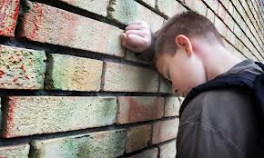 Bullied Boy at Wall