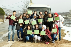 A group of Lebanese and Palestinian students proudly displays its Forgiveness Journey graduation certificates.